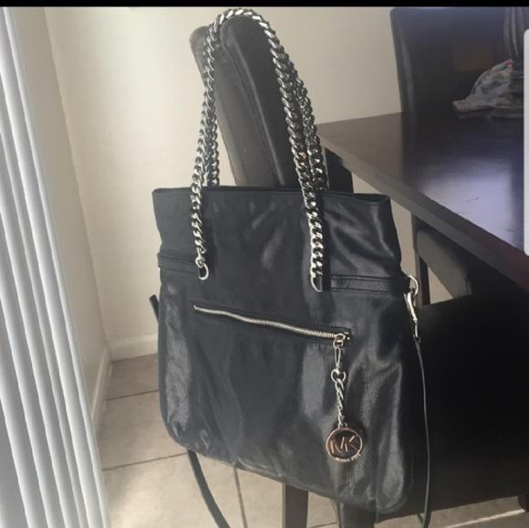black and silver MK purse